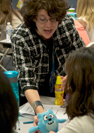 Dr. Linda LeBlanc of Auburn University illustrating how toys might be used to enhance incidental learning opportunities during a recent Master Workshop.